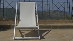 White Deck Chair on Mediterranean Terrace 4K Stock Footage