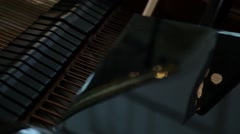 Slidershot the cheerful piano player Stock Footage