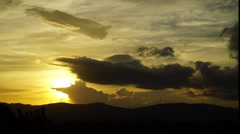Sunset clouds, hills, time-lapse Stock Footage