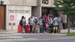 College and university students moving in to campus residence in September Stock Footage