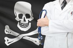 Doctor with jolly roger flag on background Stock Photos