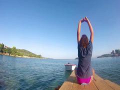 4k beach yoga , caucasian girl on a dock 4k Stock Footage
