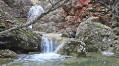 The river flows through a rocky rapids Stock Footage