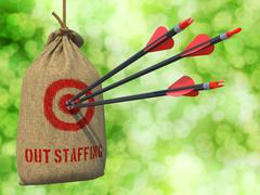 Stock Illustration of Outstaffing - Arrows Hit in Red Target.