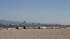 Low tide spanish banks beach - view of vancouver downtown skyline Stock Footage