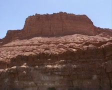 Marble Canyon, red limestone rock wall -  tilt down Colorado river at Lees Ferry Stock Footage
