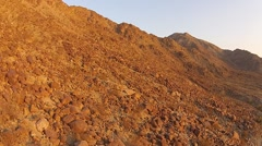 DESERT MOUNTAIN RANGE FLYOVER FROM VERY LOW ALTITUDE Stock Footage