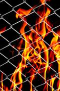 fire in a metal grid - stock photo