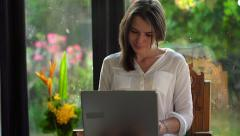 Young attractive woman working on laptop at home HD Stock Footage
