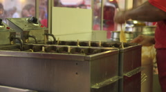 Making Corn Dogs at the County Fair - stock footage