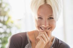 Stock Photo of Portrait of happy blonde woman smiling