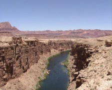 Panoramic view of Marble Canyon from Navajo Bridge + tilt down Colorado River Stock Footage