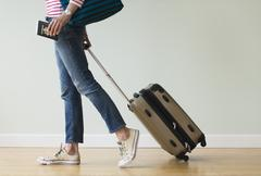Woman ready to go on vacations - stock photo