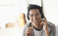 Stock Photo of Cheerful man listening to music