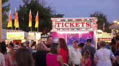Wide shot of ticket booth at county fair Stock Footage