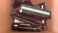 Empty Laser Printer Toner Cartridges being put in a recycling bin - stop motion. Stock Footage