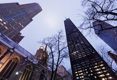 Low angle view of John Hancock Center seen from Fourth Presbyterian Church - stock photo