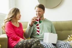 Man holding unwanted Christmas gift Stock Photos