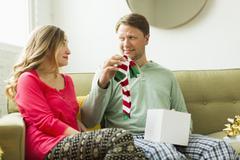 Man holding unwanted Christmas gift - stock photo