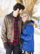 Stock Photo of Young couple looking each other, smiling