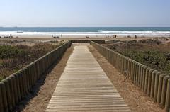 Wooden slatted walkway leading onto beach in durban south africa Stock Photos