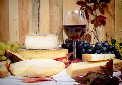 Stock Photo of french cheese platter with wine and grapes