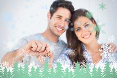 Stock Illustration of Man and wife holding a key with a house keychain