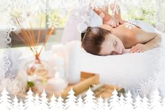 Stock Illustration of Attractive woman receiving back massage at spa center