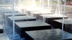 Water fountain on the city square. Modern fountain in a park - stock footage