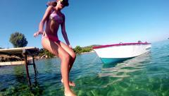 Girl jumping from springboard and diving in ocean water, slow motion for vide Stock Footage