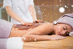 Stock Illustration of Attractive woman receiving chocolate back mask at spa center
