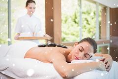 Beautiful woman receiving stone massage at health farm - stock illustration