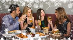Composite image of happy friends sitting together having dinner - stock illustration