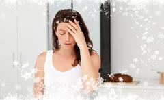 Composite image of exhausted woman having a headache in her bathroom Stock Illustration