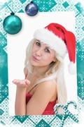 Composite image of woman wearing santa hat as she blows kiss Stock Illustration