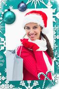 Stock Illustration of Composite image of beautiful festive woman holding shopping bag