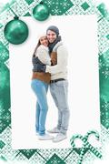 Composite image of attractive young couple in warm clothes hugging - stock illustration
