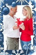 Composite image of smiling couple embracing and holding gift Stock Illustration