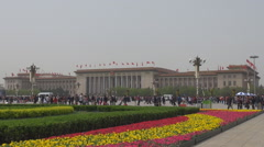 Tourist people visit Great Hall building Tiananmen Square Beijing foggy day Asia Stock Footage
