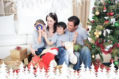 Composite image of happy family having fun with christmas presents Stock Illustration