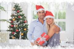 Composite image of happy couple at christmas - stock illustration