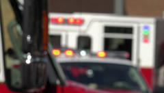 Flashing  emergency lights, fire vehicles at scene, soft focus Stock Footage