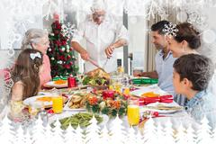 Composite image of extended family at dining table for christmas dinner - stock illustration