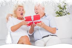 Composite image of surprising old woman receiving a gift - stock illustration