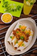 Baked meat tortilla with cheddar cheese Stock Photos