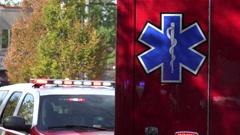 EMS Star of Life on ambulance, flashing lights bg Stock Footage