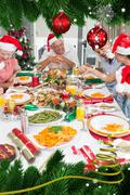 Happy family in santas hats enjoying christmas dinner - stock illustration