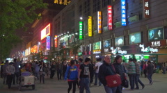 Busy Wangfujing road shopping street night Beijing crowded tourist people sign Stock Footage