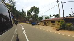 Sri Lankan tropical landscape from driving minivan. - stock footage