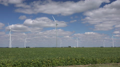 Windmill turbines in agricultural field in Midwest Stock Footage